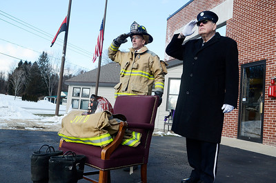 Erica Miller @togianphotog- The Saratogian, The funeral of a dedicated fireman, Louis Pasquarell Sr. of Jonesville Fire Department was laid to rest on Friday, Jan. 24th, 2014. He served 77 years as a fireman. The funeral was held at the Corpus Christi Church, Ushers 2001 Route 9, Round Lake. Dennis Lyons (left) and Allan Atwell at Station 1 saluting.