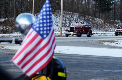 Erica Miller @togianphotog- The Saratogian, The funeral of a dedicated fireman, Louis Pasquarell Sr. of Jonesville Fire Department was laid to rest on Friday, Jan. 24th, 2014. He served 77 years as a fireman. The funeral was held at the Corpus Christi Church, Ushers 2001 Route 9, Round Lake.  Jonesville fireman Lt. Chris Schongar salutes at Station 2.