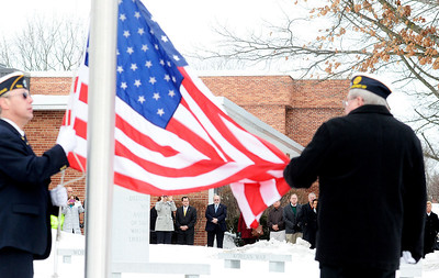 """Erica Miller @togianphotog - The Saratogian:   At the Saratoga County Board of Supervisors the flag is risen while TAPs is played during the honoring ceremony for their father Joseph Kalinkewicz at the Saratoga County """"Honoring Our Deceased Veterans"""" Ceremony held monthly."""