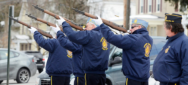"""Erica Miller @togianphotog - The Saratogian:   At the Saratoga County Board of Supervisors Ballston Spa Honor Guard fire their arms with blank ammunition during the honoring ceremony for their father Joseph Kalinkewicz at the Saratoga County """"Honoring Our Deceased Veterans"""" Ceremony held monthly."""