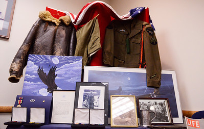 """Erica Miller @togianphotog - The Saratogian:   At the Saratoga County Board of Supervisors a display is laid out for viewing during the honoring ceremony for their father Joseph Kalinkewicz at the Saratoga County """"Honoring Our Deceased Veterans"""" Ceremony held monthly."""