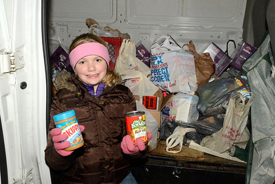 Ed Burke - The Saratogian11/27/13  Ten year old Abby McCarthy holds up food donations dropped off at the EOC van during Wednesday's visit by the Canadian Pacific Holiday Train. Abby's mother Lillian is the EOC Community Services Director.