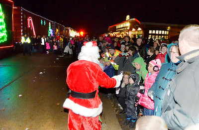 Ed Burke - The Saratogian 11/27/13 Santa Claus hands out treats during  the Canadian Pacific Holiday Train Thanksgiving eve visit to Saratoga Springs.