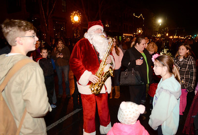 Ed Burke - The Saratogian 12/5/13 Saxaphone Santa plays for the crowds during Thursday's Victorian Streetwalk in downtown Saratoga Springs.