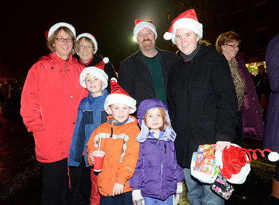 Ed Burke - The Saratogian 12/5/13 The Thompson family from Ballston Lake stroll Broadway during Thursday's Victorian Streetwalk in downtown Saratoga Springs.