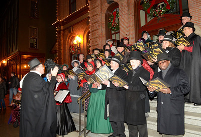 Ed Burke - The Saratogian 12/5/13 Pastor Adam Wiegand leads a choir from Saint Paul's Luthern Church during Thursday's Victorian Streetwalk in downtown Saratoga Springs.