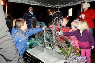 Ed Burke - The Saratogian 12/5/13 The Ice Man, Charles Jones of Hudson Falls, stands by as children touch his delicately carved sleigh of iceduring Thursday's Victorian Streetwalk in downtown Saratoga Springs. Jones is a Culinary Arts instructor for BOCES.