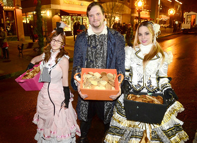 Ed Burke - The Saratogian 12/5/13 As they've done in years past, Morgan Minnolera, left, Adrian Fordrung and Heather Freitag, all of South Glens Falls, pass out cookies during Thursday's Victorian Streetwalk in downtown Saratoga Springs.