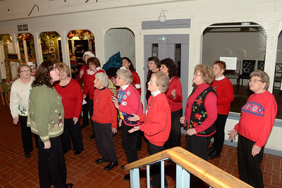 Ed Burke - The Saratogian 12/5/13 Members of the River Valley Sweet Adelines perform in the Saratoga Marketplace during Thursday's Victorian Streetwalk in downtown Saratoga Springs.