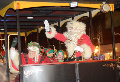 Ed Burke - The Saratogian 12/5/13 Santa and Mrs. Claus arrive with their elves for the Christmas Tree lighting during Thursday's Victorian Streetwalk in downtown Saratoga Springs.