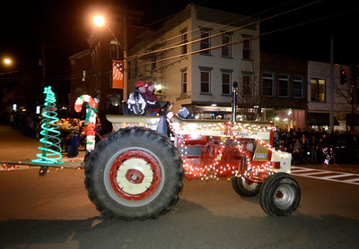 Ed Burke - The Saratogian 11/21/13 The inaugural Lighted Tractor Parade rolled through Greenwich Thursday night. The event recognized the 75th anniversary of the Greenwich chapter of the Future Farmers of America who will use funds from the event to sponsor a scholarship at Greenwich High School. The event was organized by the Greater Greenwich Chamber of Commerce.