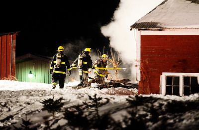 Erica Miller - The Saratogian @togianphotog      A fire broke out, possibly by a salamander on Sunday evening in South Glens Falls on Burt Road. Two residents rushed into the barn where at least three small cows and a fair cow were. At least a dozen small cows were saved that evening of Sunday the 5th of January. The fire was knocked out by the South Glens Falls Fire Department with the help from Gansvoort Fire.   SAR-l-KillianFire11