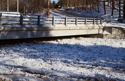 Erica Miller @togianphotog - The Saratogian.    Ice in the Kayaderosseras Creek has flooded Kelley Park in Ballston Spa on Wednesday, Jan. 8th, 2013, for the second time this winter according to neighbors. The bridge crossing over the creek on Ralph Street has be shut down with concerns for damage to the bridge. The overflow of ice has been creeping up to homes on Mechanic Street, flooding basement homes.SAR-l-IceJam1