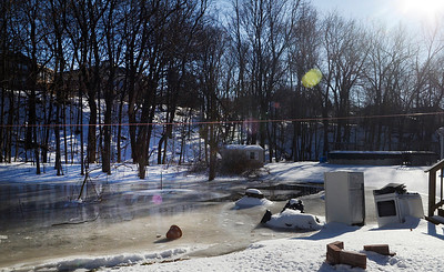 Erica Miller @togianphotog - The Saratogian.    Ice in the Kayaderosseras Creek has flooded Kelley Park in Ballston Spa on Wednesday, Jan. 8th, 2013, for the second time this winter according to neighbors. The bridge crossing over the creek on Ralph Street has be shut down with concerns for damage to the bridge. The overflow of ice has been creeping up to homes on Mechanic Street, flooding basement homes.SAR-l-IceJam7