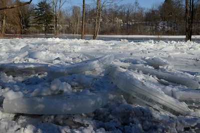 Erica Miller @togianphotog - The Saratogian.    Ice in the Kayaderosseras Creek has flooded Kelley Park in Ballston Spa on Wednesday, Jan. 8th, 2013, for the second time this winter according to neighbors. The bridge crossing over the creek on Ralph Street has be shut down with concerns for damage to the bridge. The overflow of ice has been creeping up to homes on Mechanic Street, flooding basement homes.SAR-l-IceJam4