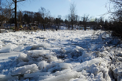Erica Miller @togianphotog - The Saratogian.    Ice in the Kayaderosseras Creek has flooded Kelley Park in Ballston Spa on Wednesday, Jan. 8th, 2013, for the second time this winter according to neighbors. The bridge crossing over the creek on Ralph Street has be shut down with concerns for damage to the bridge. The overflow of ice has been creeping up to homes on Mechanic Street, flooding basement homes.SAR-l-IceJam2