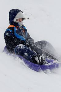 Erica Miller @togianphotog - The Saratogian:     Enjoying the snow on a snow day Quinn Frank, 10 years old from Saratoga Springs, glides down the hill in Congress Park on Wednesday afternoon, February 5th, 2014, the beginning of the snow storm hitting the North Eastern area. Snow will continue to fall till early evening.