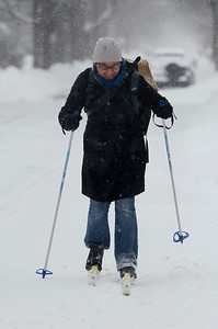 Erica Miller @togianphotog - The Saratogian:     Cora Burns, a resident on Caroline Street, skis her way down the road in Saratoga Springs on her way to work at her store Paperline, on Broadway, on Wednesday morning, February 5th, 2014, the beginning of the snow storm hitting the North Eastern area. Snow will continue to fall till early evening.