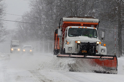 Erica Miller @togianphotog - The Saratogian:     Saratoga Springs DPW on North Broadway on Wednesday morning, February 5th, 2014, plowing the beginning of the snow storm hitting the North Eastern area. Snow will continue to fall till early evening.