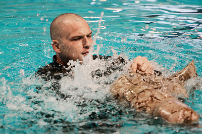 Erica Miller @togianphotog - The Saratogian. Sgt. Michael McDonald, team leader of MCIWS, spoke as Sgt. Richard Korhonen (shown) was in the water demonstrating water survival techniques,Thursday February 13, 2014.