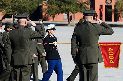 Erica Miller @togianphotog - The Saratogian:     In Parris Island at the Recruit Training Regiment Marine Corps Recruit Depot, as recruits march to be saluted on graduation day on Friday  February 14th, 2014, as Saratoga recruit Company Honor Grad Justine Woodend passed the officers.
