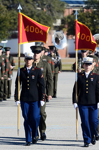 Erica Miller @togianphotog - The Saratogian:     In Parris Island at the Recruit Training Regiment Marine Corps Recruit Depot, as recruits march on graduation day on Friday  February 14th, 2014, as Saratoga recruit Company Honor Grad Justine Woodend heads to retire of the Guidons.