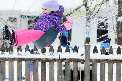 Erica Miller @togianphotog - The Saratogian:  After a evening of snow fall the students at the Waldorf School on Lake Ave enjoyed playing in the snow. Violet Noxon swung on a swing on their play-set bundled up with snow gear.