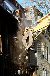 Erica Miller @togianphotog - The Saratogian     Demolition at 66 Franklin Street began Thursday, a long debate in Saratoga Springs for many years. Cristo Demolition, from Albany, began work around noon in the city. The company said they had to wait 14 days till they could began. The state Supreme Court Appellate Division upheld a lower court decision to allow the demolition on October 24th. Joseph Boff is the owner of the building who resides in Florida. Demolition was stopped mid-afternoon due to the need for a larger excavating machine.SAR-l-66FranklinDEMO9