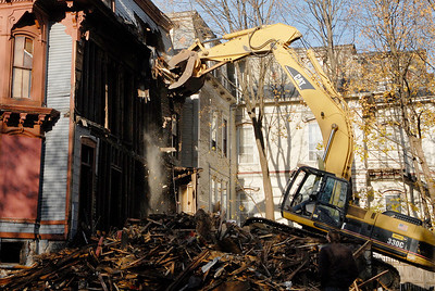 Erica Miller @togianphotog - The Saratogian     Demolition at 66 Franklin Street began Thursday, a long debate in Saratoga Springs for many years. Cristo Demolition, from Albany, began work around noon in the city. The company said they had to wait 14 days till they could began. The state Supreme Court Appellate Division upheld a lower court decision to allow the demolition on October 24th. Joseph Boff is the owner of the building who resides in Florida. Demolition was stopped mid-afternoon due to the need for a larger excavating machine.SAR-l-66FranklinDEMO5