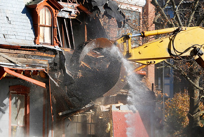 Erica Miller @togianphotog - The Saratogian     Demolition at 66 Franklin Street began Thursday, a long debate in Saratoga Springs for many years. Cristo Demolition, from Albany, began work around noon in the city. The company said they had to wait 14 days till they could began. The state Supreme Court Appellate Division upheld a lower court decision to allow the demolition on October 24th. Joseph Boff is the owner of the building who resides in Florida. Demolition was stopped mid-afternoon due to the need for a larger excavating machine.SAR-l-66FranklinDEMO1