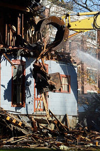 Erica Miller @togianphotog - The Saratogian     Demolition at 66 Franklin Street began Thursday, a long debate in Saratoga Springs for many years. Cristo Demolition, from Albany, began work around noon in the city. The company said they had to wait 14 days till they could began. The state Supreme Court Appellate Division upheld a lower court decision to allow the demolition on October 24th. Joseph Boff is the owner of the building who resides in Florida. Demolition was stopped mid-afternoon due to the need for a larger excavating machine.SAR-l-66FranklinDEMO6