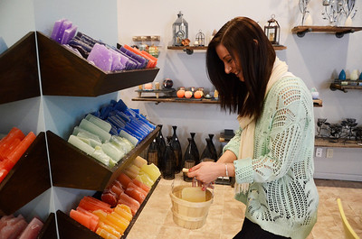 Erica Miller @togianphotog - The Saratogian:  The Candle Collective opened their doors recently in Ballston Spa at the Factory buildings on 20 Prospect Street. Co-owners Morgan Boswell had many of different colors of wax on display where customers can build their own customized candles. Customer and friend Mindy Gilman created her own candle on Wednesday.