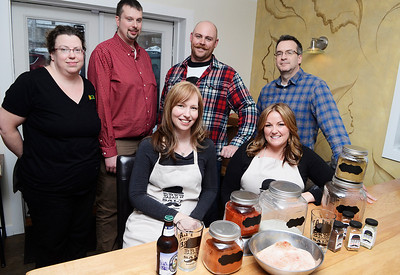 Erica Miller @togianphotog - The Saratogian: Nestled in the back kitchen of Zest, in Ballston Spa on Science Street. The business is new engaging people to put organic flavored beer salts in their drinks, or even desserts. The Brew Salt crew, front seated are Robin Morgan and Kerri Tanner. Back (L-R) Zest owners Eric and Carla Kuchar, Patrick McGowin and James Morgan.