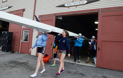 Erica Miller @togianphotog - The Saratogian:   The girls 8's while at practice on Wednesday afternoon on Saratoga Lake and in the gym in preparation for the upcoming Regatta. The regatta is up 30% since last year, making 10 lanes this year.