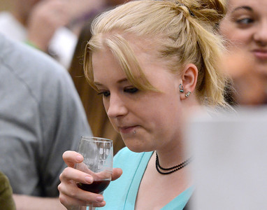 Ed Burke - The Saratogian 04/19/14 Visiting friends, Nicole Miller of North Carolina samples a wine at Saturday's Taste of Upstate Wine, Food and Music Festival at the city center.