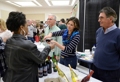 Ed Burke - The Saratogian 04/19/14 Altamont Vineyard and Winery founder Louis DiCrecsenzo looks on as Dana Carlascio serves a sample from their pressings. Dana's father Frank is at left.