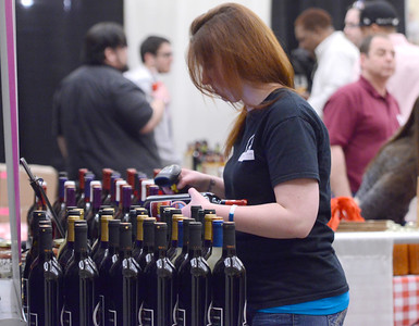Ed Burke - The Saratogian 04/19/14 Jennifer Hoffman of Coyote Moon Vineyards of Clayton, New York rings up a sale at the Taste of Upstate Wine, Food and Music Festival Saturday at the Saratoga Springs City Center.