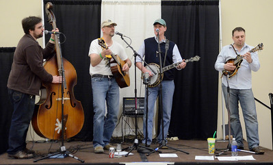 """Ed Burke - The Saratogian 04/19/14 Upstate band Flood Road plays their version of """"acoustic folkgrass"""" at the Taste of Upstate Wine, Food and Music Festival Saturday at the Saratoga Springs City Center."""