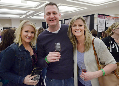 Ed Burke - The Saratogian 04/19/14 From left: Rachael and Wade Rodenmayer along with Emilee Greenhouse of Saratoga Springs attend Saturday's Taste of Upstate Wine, Food and Music Festival at the city center.