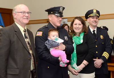 Ed Burke - The Saratogian 03/18/14 With his wife Kelly at his side, new Saratoga Springs Police officer Officer Wade Collins holds his three month old daughter Finley after being sworn-in with three others during Tuesday's city council meeting. Public Safety Commissioner Chris Mathiesen at left and Chief Greg Veitch at right.