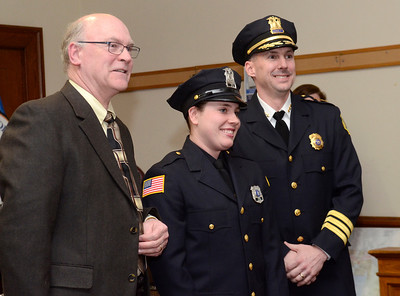 Ed Burke - The Saratogian 03/18/14 New officer Saratoga Springs police officer Jenna Carson stands with Chief Greg Veitch and Public Safety Commissioner Chris Mathiesen after being sworn-in at Tuesday's city council meeting.