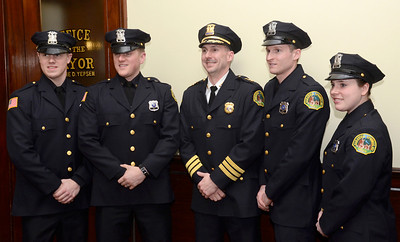 Ed Burke - The Saratogian 03/18/14 New officers stand with Saratoga Springs Police Chief Greg Veitch after being sworn-in during Tuesday's city council meeting. From left: Officers Greg Lewis and Wade Collins, Chief Veitch, and Officers Jonathan Van Wie and Jenna Carson.