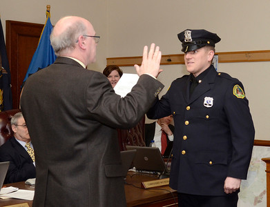 Ed Burke - The Saratogian 03/18/14 Officer Wade Collins is sworn-in as a new Saratoga Springs police officer by Public Safety Commissioner Chris Mathiesen during Tuesday's city council meeting.