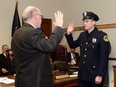 Ed Burke - The Saratogian 03/18/14 Officer Jonathan Van Wie is sworn-in as a new Saratoga Springs police officer by Public Safety Commissioner Chris Mathiesen during Tuesday's city council meeting.