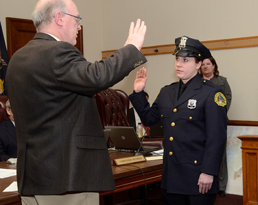 Ed Burke - The Saratogian 03/18/14 Officer Jenna Carson is sworn-in as a new Saratoga Springs police officer by Public Safety Commissioner Chris Mathiesen during Tuesday's city council meeting.