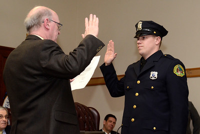 Ed Burke - The Saratogian 03/18/14 Officer Greg Lewis is sworn-in as a new Saratoga Springs police officer by Public Safety Commissioner Chris Mathiesen during Tuesday's city council meeting.