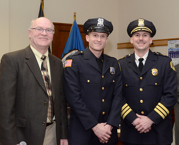 Ed Burke - The Saratogian 03/18/14 New Saratoga Springs police officer Jonathan Van Wie stands with Chief Greg Veitch and Public Safety Commissioner Chris Mathiesen after being sworn-in at Tuesday's city council meeting.