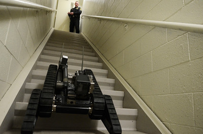 Erica Miller @togianphotog - The Saratogian:   At the Saratoga County Sheriff's Department in Ballston Spa, Deputy Dave Petrie demonstrated how the iRobot works. The iRobot is used for multiple details the Sheriff's go on, including up and down stairs as show in one of their stairwells.