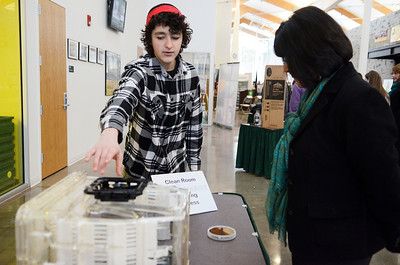 Erica Miller @togianphotog	- The Saratogian,   At Hudson Valley Community College's TEC-SMART on Tuesday morning, Jan. 21st 2014, students from 20 different schools gathered in the lobby to show off their first semester projects to parents and dignitaries. Schuyerlville Senior Rich Zotzmann, 17 years old, showed Monica Hunter, Director of Research from The PAST Foundation in Columbus OH, the Clean room and wafers.