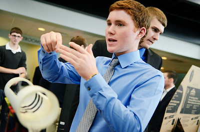Erica Miller @togianphotog	- The Saratogian,   At Hudson Valley Community College's TEC-SMART on Tuesday morning, Jan. 21st 2014, students from 20 different schools gathered in the lobby to show off their first semester projects to parents and dignitaries. Stillwater seniors Lukas Dunn, back, and Joe DeMarco describe their H2Overwatch for water safety semester project.